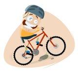 O homem engraçado dos desenhos animados está montando um Mountain bike Imagens de Stock Royalty Free