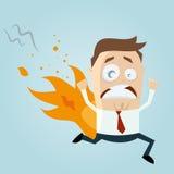O homem engraçado dos desenhos animados está no fogo Fotografia de Stock Royalty Free