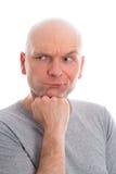 O homem engraçado com cabeça calva refacting Imagem de Stock Royalty Free