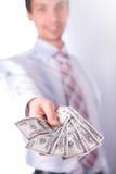 O homem estica o dinheiro Fotos de Stock