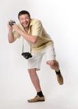 O homem fresco nos shorts o fotógrafo Fotos de Stock