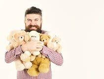 O homem generoso preparou muitos ursos de peluche como presentes imagem de stock royalty free
