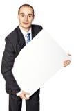 O homem guarda o cartaz. Fotos de Stock
