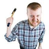 O homem irritado balança um martelo grande Fotografia de Stock Royalty Free