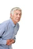 O homem japonês superior sofre da dor de estômago Fotos de Stock