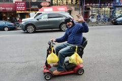 O homem monta um veículo da mobilidade fotos de stock royalty free