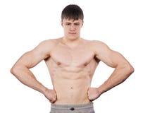 O homem mostra o bíceps imagem de stock royalty free