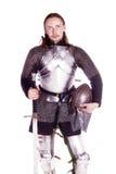 O homem na armadura. Cavaleiro. Imagens de Stock