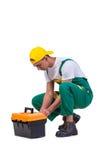 O homem novo com a caixa de ferramentas do conjunto de ferramentas isolada no branco Fotografia de Stock