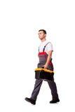 O homem novo com a caixa de ferramentas do conjunto de ferramentas isolada no branco Foto de Stock Royalty Free