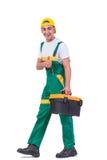 O homem novo com a caixa de ferramentas do conjunto de ferramentas isolada no branco Fotos de Stock