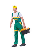 O homem novo com a caixa de ferramentas do conjunto de ferramentas isolada no branco Imagens de Stock Royalty Free