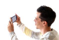 O homem novo com dispositivo fotografia de stock royalty free