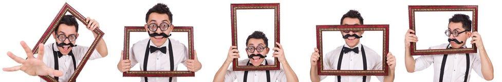 O homem novo com o quadro isolado no branco Fotografia de Stock Royalty Free