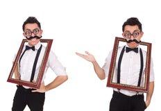 O homem novo com o quadro isolado no branco Imagens de Stock Royalty Free