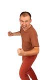 O homem novo com punhos e gritaria ameaça foto de stock royalty free