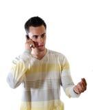 O homem novo com telefone fotografia de stock royalty free