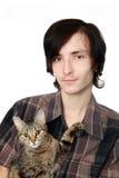 O homem novo com um gato Fotografia de Stock