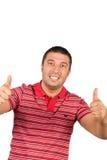 O homem novo dá os polegares - acima Fotografia de Stock