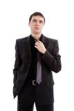 O homem novo em um terno, laço desatou. Fotografia de Stock