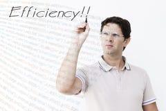 O homem novo está escrevendo o ` da eficiência do ` foto de stock royalty free