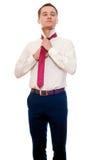 O homem novo está vestindo um terno isolado no branco Homem de negócios ou st Fotos de Stock Royalty Free