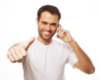 o homem novo ocasional que mostra os polegares levanta o sinal Foto de Stock Royalty Free