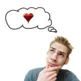 O homem novo pensa o amor imagens de stock royalty free