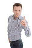 O homem novo que agita o dedo em você isolou-se no fundo branco Foto de Stock