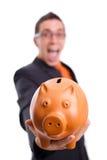 O homem prende um banco piggy Fotos de Stock