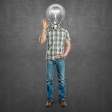 O homem principal da lâmpada mostra ESTÁ BEM Imagem de Stock