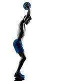 O homem que exercita a aptidão torna mais pesada a silhueta dos exercícios Fotografia de Stock Royalty Free
