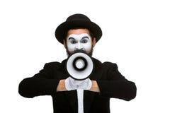 O homem que guarda o megafone faz o ruído alto Imagens de Stock