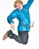 O homem que salta no traje fotografia de stock