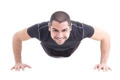 O homem árabe farpado considerável em fazer do sportswear empurra isolado acima Imagens de Stock