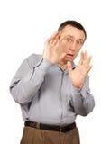 O homem Scared é fechado pelas mãos fotos de stock royalty free