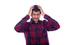 O homem tem uma dor de cabeça Fotos de Stock