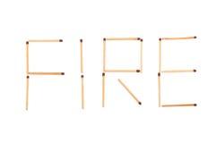 O incêndio da palavra feito dos fósforos Fotos de Stock