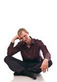 O indivíduo adulto senta-se Foto de Stock