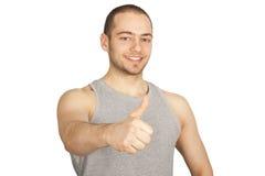 O indivíduo novo que mostra os polegares levanta o sinal Fotografia de Stock