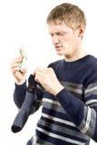 O indivíduo põr o dinheiro em uma peúga Fotografia de Stock Royalty Free
