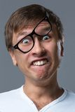 O indivíduo principal grande faz emoções loucas da cara Imagem de Stock