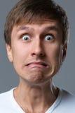 O indivíduo principal grande faz emoções loucas da cara Imagem de Stock Royalty Free