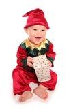 O infante vestiu-se no traje pequeno do vestido de fantasia do ajudante de Santa dos elfs fotografia de stock royalty free