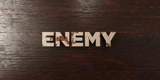 O inimigo - título de madeira sujo no bordo - 3D rendeu a imagem conservada em estoque livre dos direitos ilustração do vetor