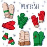 O inverno ajustou-se com os mitenes handdrawn em cores brilhantes Foto de Stock