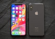 O iPhone o mais atrasado X da geração, a parte dianteira e os versos Fotografia de Stock Royalty Free