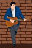 O jogador de guitarra acústica Imagens de Stock
