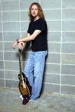 O jogador de guitarra da ligação Fotografia de Stock