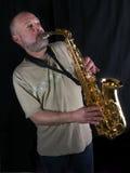 O jogador de saxofone imagens de stock